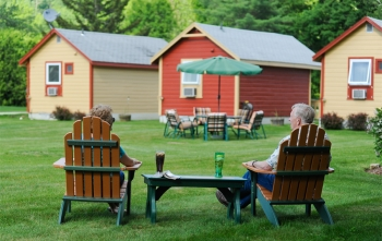 Casablanca guests relax in Adirondack chairs